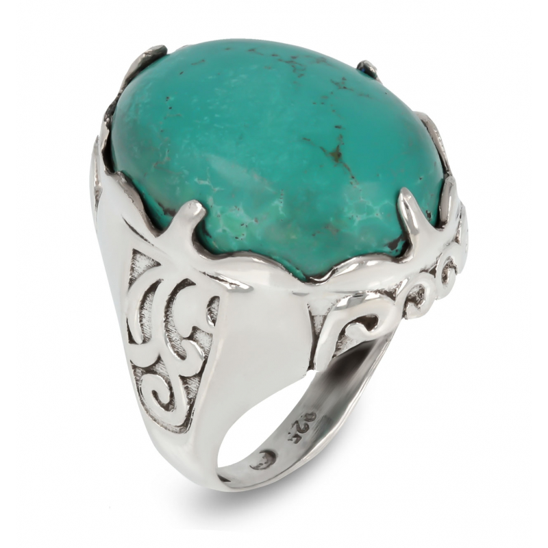 Ring in turquoise mounted on silver ring dotted with arabesques